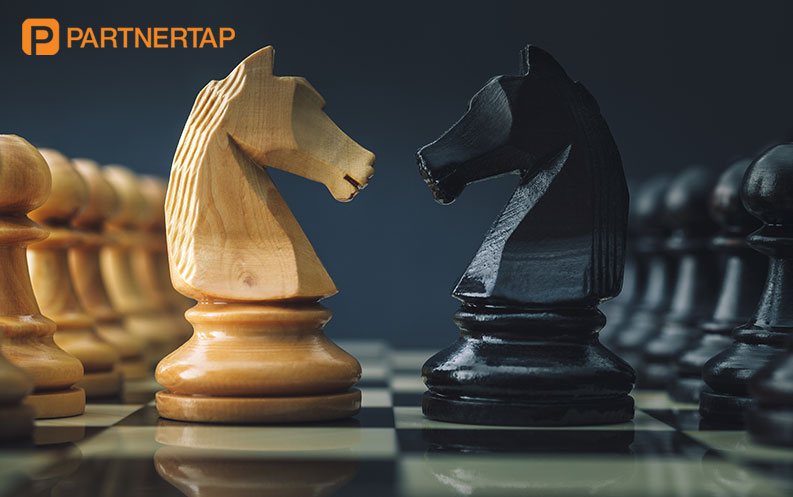 Two Chess Pieces Looking at Each Other