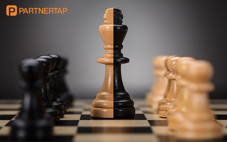 Two chess pieces come together like an M&A deal