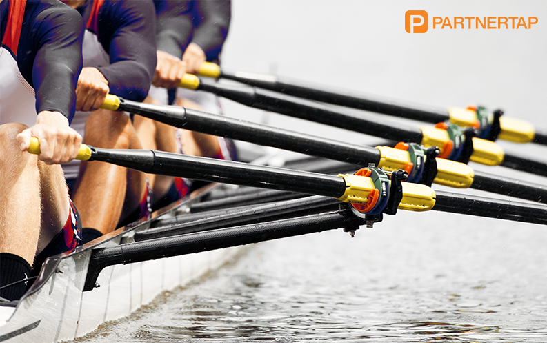 image of rowing team rowing together